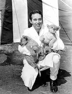 Dave Hoover with lion cubs