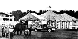 Lewis Bros. Circus midway and elephant ride